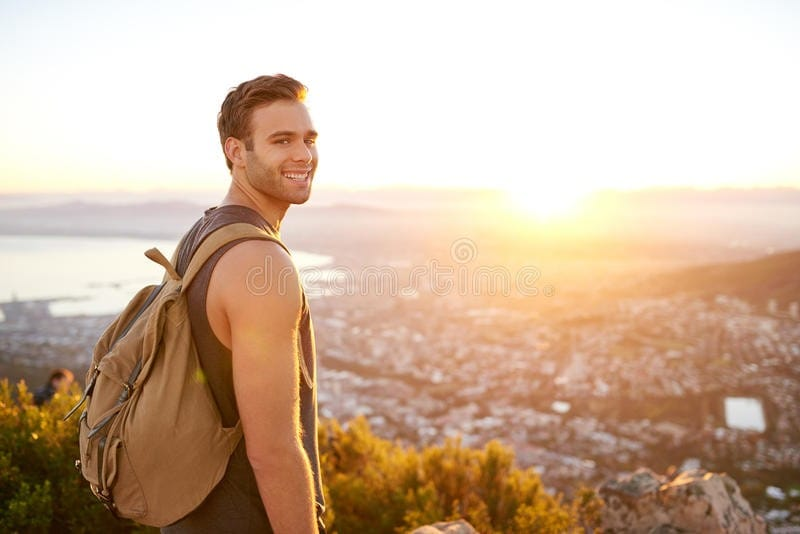 young-man-nature-trail-view-city-smiling-standing-early-morning-55415162.jpg